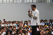 Incumbent Thailand president and Democratic hopeful Abhisit Vejjajiva speaks and presses the flesh during a  campaign stop at a public school in Mae Rim Thailand.