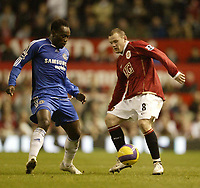Photo: Aidan Ellis.<br /> Manchester United v Chelsea. The Barclays Premiership. 26/11/2006.<br /> United's Wayne Rooney loses out to Chelsea's Michael Essien