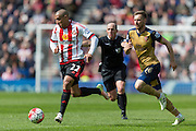 Sunderland's Midfielder Wahbi Khazri (22) chased byArsenal midfielder Aaron Ramsey (16) during the Barclays Premier League match between Sunderland and Arsenal at the Stadium Of Light, Sunderland, England on 24 April 2016. Photo by George Ledger.