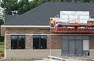 Jeremy Blumley of Dubuque works on the outside of the Stonefield Commercial Center in Marion on Friday morning, September 2, 2011. Blumley works for Cummer Masonry.