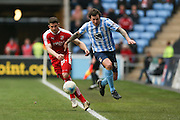 Coventry City forward Darius Henderson (44) gets away from Swindon Town defender Jamie Sendles-White (21)   during the Sky Bet League 1 match between Coventry City and Swindon Town at the Ricoh Arena, Coventry, England on 19 March 2016. Photo by Simon Davies.
