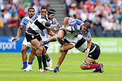 Samoa Outside Centre Paul Perez is tackled by Barbarians Lock Luke Jones (Melbourne Rebels)  - Mandatory byline: Rogan Thomson/JMP - 07966 386802 - 29/08/2015 - RUGBY UNION - The Stadium at Queen Elizabeth Olympic Park - London, England - Barbarians v Samoa - International Friendly.