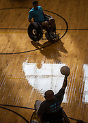 Tim Guiden, from Bellbrook, throws the ball back while Josh Becker watches during the 5th annual Quad Rugby event in the Charles J. Ping Recreation Center on September 15, 2012.