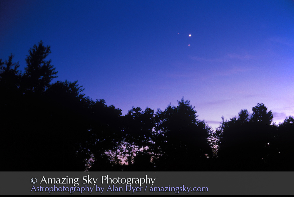 Triple planet conjunction, June 17, 1991<br /> <br /> Venus at top, Jupiter below, Mars at left. <br /> <br /> Taken from home in southwest Wisconsin, near Eagle, WI. 105mm lens. Exposure and film not recorded.