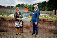 7-6-2016 APELDOORN - Princess Margriet and Professor Pieter van Vollenhoven perform Friday, June 17th in the gardens of the museum Het Loo Palace in Apeldoorn, the opening of the exhibition 'Blue &amp; Fur, Delftware in the palace gardens. Princess Margriet and Professor Pieter van Vollenhoven perform Friday, June 17th in the gardens of the museum Het Loo Palace in Apeldoorn, the opening of the exhibition 'Blue &amp; Fur, Delftware in the palace gardens. In the summer season in the gardens of the museum Palace Het Loo 45 Specialty see Delft blue vases. The vases are made for example of three existing originals, created in the 17th century for the first inhabitants of Het Loo Palace, King-William III and Queen Mary. Of the original vases on Het Loo are left only fragments. Across Europe obsolete three original royal vases, which served as a model for making the replicas. Delftware vases were in the 17th century exclusive eye-catchers in many baroque gardens. They were then filled with exotic plants and orange trees and pineapple plants.<br /> COPYRIGHT ROBIN UTRECHT 17-6-2016 APELDOORN - Prinses Margriet en Pieter van Vollenhoven tijdens de opening van de tentoonstelling Blauw &amp; Bont, Delfts blauw in de paleistuinen op Paleis Het Loo.  Prinses Margriet en prof.mr. Pieter van Vollenhoven verrichten vrijdag 17 juni in de tuinen van museum Paleis Het Loo in Apeldoorn de opening van de tentoonstelling 'Blauw &amp; Bont, Delfts blauw in de paleistuinen&rsquo;. Prinses Margriet en prof.mr. Pieter van Vollenhoven verrichten vrijdag 17 juni in de tuinen van museum Paleis Het Loo in Apeldoorn de opening van de tentoonstelling 'Blauw &amp; Bont, Delfts blauw in de paleistuinen&rsquo;. In het zomerseizoen zijn in de tuinen van museum Paleis Het Loo 45 bijzondere Delfts blauwe vazen te zien. De vazen zijn vervaardigd naar voorbeeld van drie nog bestaande originelen, die in de 17e eeuw zijn gemaakt voor de eerste bewoners van Paleis Het Loo, Koning-stadhouder Willem III en Koningin Mary. Van de oorspronkelijk