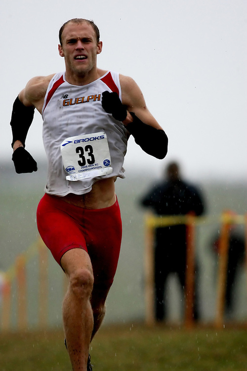 (Kingston, ON---25 October 2008) Derek Snider of GUELPH University running to finish 9 in the 2008 Ontario University Athletics men's cross country championship.  Photograph copyright Sean Burges/Mundo Sport Images (www.msievents.com).