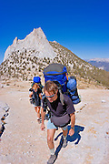 Backpackers under Cathedral Peak, Tuolumne Meadows area, Yosemite National Park, California