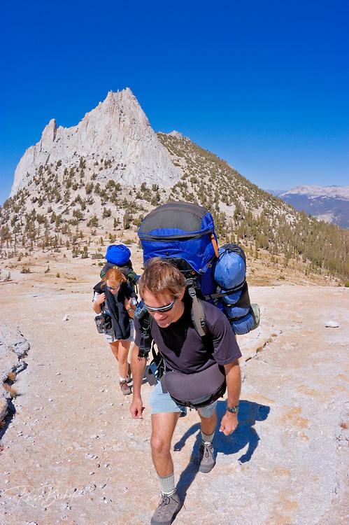 Backpackers under Cathedral Peak, Tuolumne Meadows area, Yosemite National Park, California