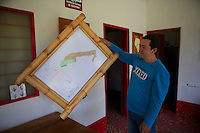 Wilmar Velasquez, shows the map of his finca San Carlos in the Vereda Las Andes in the municipality of Salgar in southwest Antioquia. The coffee finca of 4 Ha. has been in the family for several generations and Wilmar returned here seven years ago after the family had to flee the violence 20 years ago. He mostly works in the fields himself as well, and he has two men working permanently for him besides several more during harvest times.