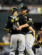 Sep. 20 2011; Phoenix, AZ, USA; Pittsburgh Pirates catcher Ryan Doumit (41) congratulates pitcher Joel Hanrahan (left) after defeating Arizona Diamondbacks in the ninth inning at Chase Field.  The Pirates defeated the Diamondbacks 5 - 3. Mandatory Credit: Jennifer Stewart-US PRESSWIRE..