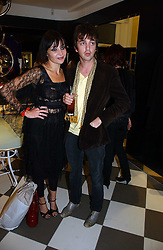 PEARL LOWE and musician DANNY GOFFEY at a party to celebrate the opening of PPQ Mayfair at 47 Conduit Street, London W1 on 18th September 2006.<br />
