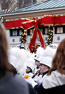 The Beavercreek High School marching band entertains the crowd as they wait for Santa's parade and the tree lighting celebration at The Greene towne square in Beavercreek, Saturday, November 19, 2011.