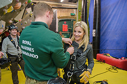 Royal Marines abseil down BT Tower. the BT Tower, London, United Kingdom. Embargoed until Monday, 17th February 2014. Picture by Anthony Upton / i-Images<br /> <br /> Marine Sam Magowan with TV presenter Helen Skelton during the training at the Castle Climbing centre, in north London ahead of the first ever charity abseil down BT Tower will take place on 10 March to raise money for Sport Relief and the Royal Marines Charitable Trust Fund using BT's MyDonate online fundraising site.<br /> <br /> The event will also kick off a year of celebrations for the 350th anniversary of the Royal Marines, during which the Royal Marines Charity Trust Fund (RMCTF) aim to raise £6million