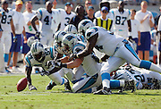 CHARLOTTE, NC - SEPTEMBER 18:  Linebacker Dan Morgan #55 of the Carolina Panthers recovers a fumble by the New England Patriots late in the fourth quarter at Bank of America Stadium on September 18, 2005 in Charlotte, North Carolina. The Panthers defeated the Patriots 27-17. ©Paul Anthony Spinelli *** Local Caption *** Dan Morgan