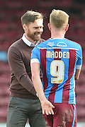 Graham Alexander manager of Scunthorpe United and Paddy Madden of Scunthorpe United at the end of their 6-0 win  during the Sky Bet League 1 match between Scunthorpe United and Swindon Town at Glanford Park, Scunthorpe, England on 28 March 2016. Photo by Ian Lyall.