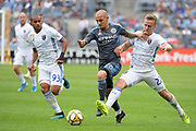 Alexandru Mitrita NYCFC gets away from Judson Thompson  and Tommy Thompson of the San Jose Earthquakes during a MLS soccer game, Saturday, Sept. 14, 2019, in New York.NYCFC defeated San Jose Earthquakes 2-1.(Errol Anderson/Image of Sport)