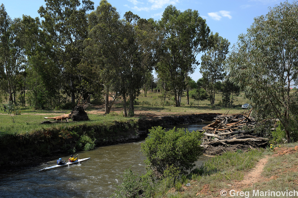 Canoeists paddle along  the Klip River near Meyerton, south of Johannesburg, during a heat wave November 13, 2011.  The Vaal River basin extends across the economic and industrial heartland of South Africa. Photo Greg Marinovich / Storytaxi.com