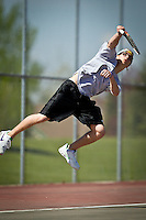 Lake City High's Matt Gencarella remains elevated after smashing a serve toward his opponents from Lewiston High Saturday during the 5A Region 1 tournament.