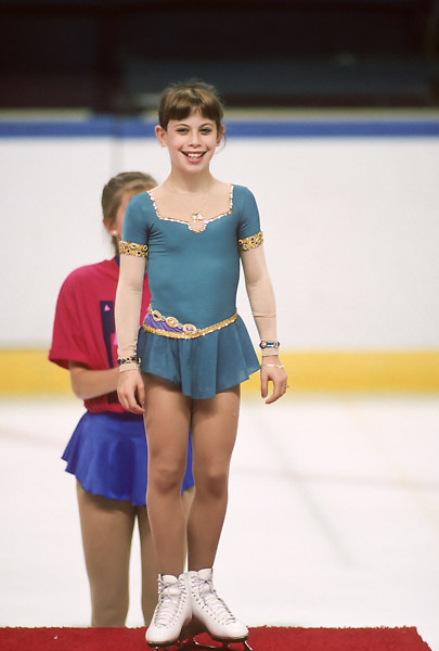 ST. LOUIS  -  JULY 1994:  Tara Lipinski (USA) appears on the awards stand after winning the Ladies' Singles figures skating event of the 1994 United States Olympic Festival held in July 1994 in St. Louis, Missouri.  Lipinski was 14 years old at the time. (Photo by David Madison/Getty Images) *** Local Caption *** Tara Lipinski