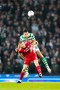 Filip Benkovic (#32) of Celtic wins the header in midfield during the Betfred Cup Final between Celtic and Aberdeen at Celtic Park, Glasgow, Scotland on 2 December 2018.