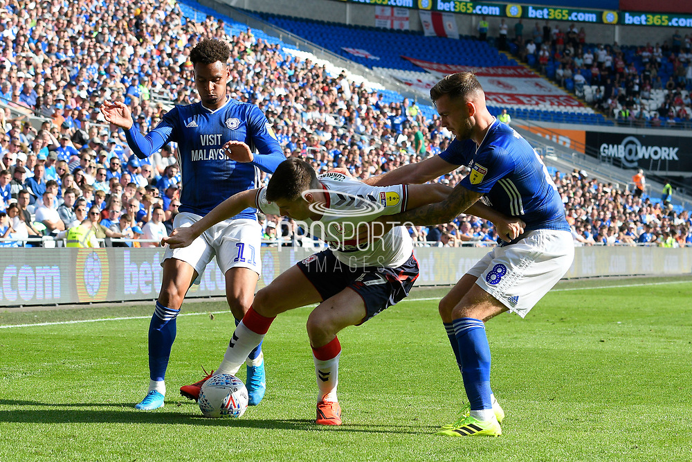 Paddy McNair (17) of Middlesbrough battles for possession with Joe Ralls (8) of Cardiff City during the EFL Sky Bet Championship match between Cardiff City and Middlesbrough at the Cardiff City Stadium, Cardiff, Wales on 21 September 2019.