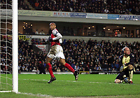 Photo: Paul Thomas.<br /> Blackburn Rovers v Arsenal. The Barclays Premiership. 13/01/2007.<br /> <br /> Goal scorer Thierry Henry (L) runs off to celebrate while Blackburn goal keeper Brad Friedel looks away.