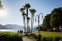 VERBANIA, ITALY - 18 APRIL 2017: People walk by the Lake Maggiore in Verbania, Italy, on April 18th 2017.<br /> <br /> Emma Morano was an Italian supercentenarian who, prior to her death at the age of 117 years and 137 days, was the world's oldest living person whose age had been verified, and the last living person to have been verified as being born in the 1800s. She died on April 15th 2017.