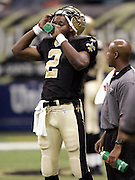 NEW ORLEANS - OCTOBER 10:  Aaron Brooks #2 of the New Orleans Saints takes a Gatorade break against the Tampa Bay Buccaneers at the Louisiana Superdome on October 10, 2004 in New Orleans, Louisiana. The Bucs defeated the Saints 20-17. ©Paul Anthony Spinelli *** Local Caption *** Aaron Brooks