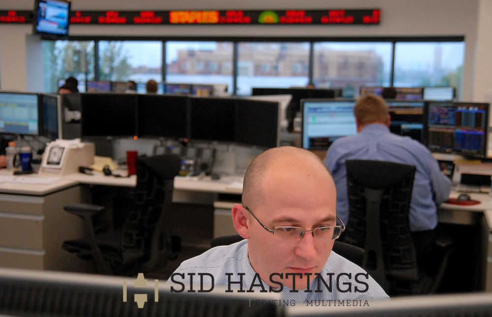 20 MAY 2010 -- ST. LOUIS -- Istvan Veszi works as a ticker flashes current stock prices on the trading floor at Wells Fargo Advisors in St. Louis Thursday, May 20, 2010. The company opened a new, high-tech trading floor in March. Photo © copyright 2010 Sid Hastings.