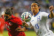 Turkey #24 Osman Gamdal (L) competes for the ball with Honduras #15 Roger Espinoza (R) during their international friendly soccer match at RFK Stadium in Washington May 29, 2014.  REUTERS/Jonathan Ernst    (UNITED STATES)