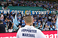 SYDNEY, AUSTRALIA - APRIL 06: Sydney FC supporter marshal looks at the cove prior to kick off at round 24 of the Hyundai A-League Soccer between Sydney FC and Melbourne Victory on April 06, 2019, at The Sydney Cricket Ground in Sydney, Australia. (Photo by Speed Media/Icon Sportswire)