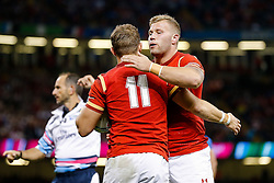 Wales Winger Hallam Amos celebrates scoring a try with replacement Ross Moriarty - Mandatory byline: Rogan Thomson/JMP - 07966 386802 - 20/09/2015 - RUGBY UNION - Millennium Stadium - Cardiff, Wales - Wales v Uruguay - Rugby World Cup 2015 Pool A.
