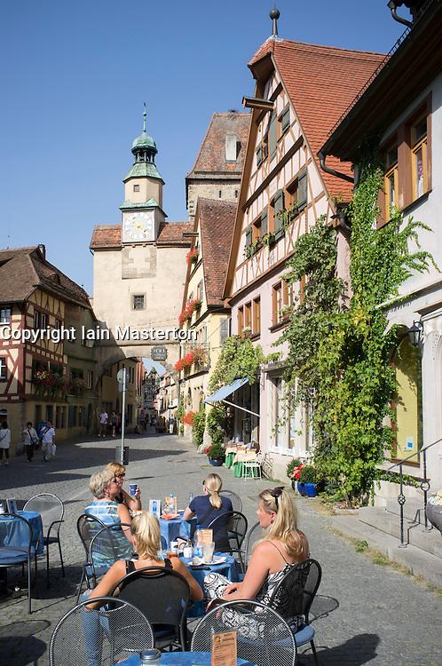 outdoor cafe in Rothenburg ob der Tauber medieval town in Bavaria Germany