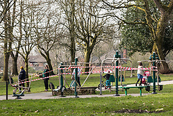 © Licensed to London News Pictures. 24/03/2020. Salford, UK. An exercise and workout area in Lightoaks Park in Salford , Greater Manchester , is taped off to prevent the use of communal facilities , as the British government issues instructions to reduce social contact as part of quarantine measures to prevent the spread of Coronavirus ( COVID-19 ) . Photo credit: Joel Goodman/LNP
