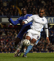 Photo: Paul Thomas.<br /> Chelsea v Wycombe Wanderers. Carling Cup, Semi Final 2nd Leg. 23/01/2007.<br /> <br /> Jermaine Easter (R) of Wycombe holds off Lassana Diarra.