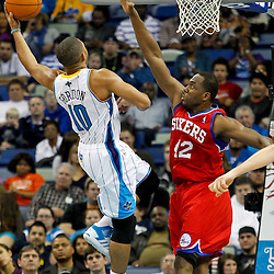 January 4, 2012; New Orleans, LA, USA; New Orleans Hornets shooting guard Eric Gordon (10) shoots over Philadelphia 76ers power forward Elton Brand (42) during the second half of a game at the New Orleans Arena. The 76ers defeated the Hornets 101-93.  Mandatory Credit: Derick E. Hingle-US PRESSWIRE