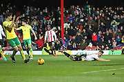 Brentford striker Scott Hogan (9) appealing for a penalty during the EFL Sky Bet Championship match between Brentford and Norwich City at Griffin Park, London, England on 31 December 2016. Photo by Matthew Redman.