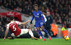Arsenal's Sokratis Papastathopoulos (left) and Chelsea's Callum Hudson-Odoi (centre) battle for the ball during the Premier League match at The Emirates Stadium, London.