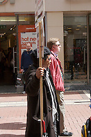 Man holding an advertising sign on Grafton Street in Dublin Ireland