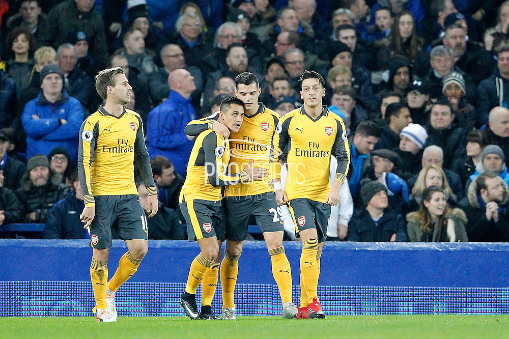Arsenal's Alexis Sanchez (7) celebrates scoring the opening goal of the gamw 0-1 during the Premier League match between Everton and Arsenal at Goodison Park, Liverpool, England on 13 December 2016. Photo by Craig Galloway.