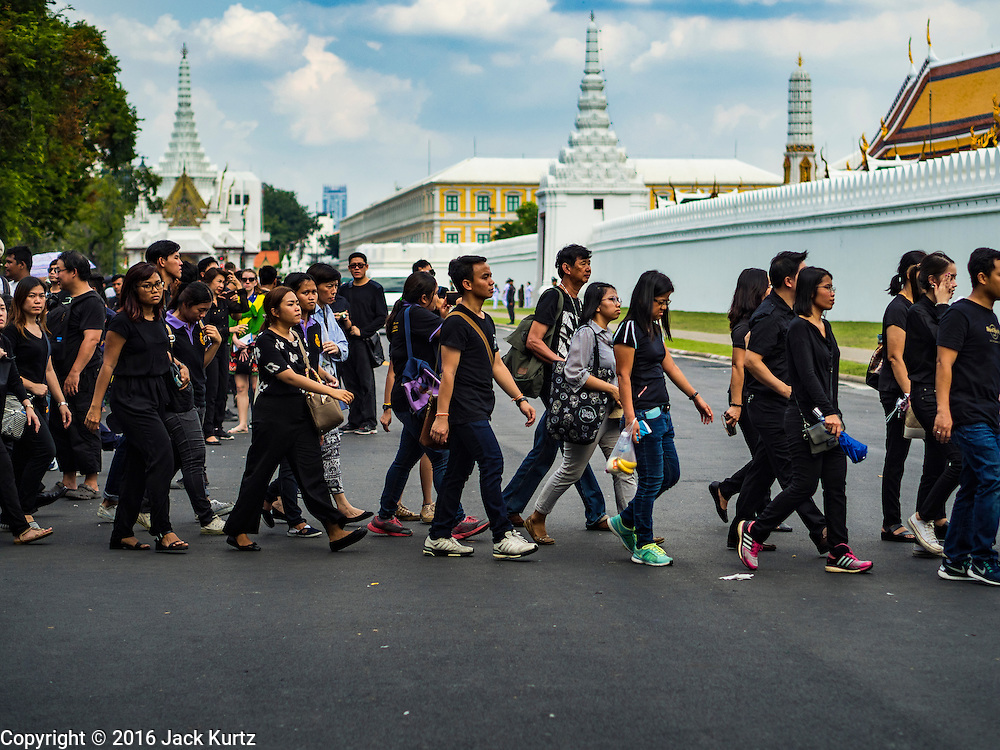 15 OCTOBER 2016 - BANGKOK, THAILAND: People walk into the Grand Palace to sign condolences books for Bhumibol Adulyadej, the King of Thailand. King Bhumibol Adulyadej died Oct. 13, 2016. He was 88. His death comes after a period of failing health. With the king's death, the world's longest-reigning monarch is Queen Elizabeth II, who ascended to the British throne in 1952. Bhumibol Adulyadej, was born in Cambridge, MA, on 5 December 1927. He was the ninth monarch of Thailand from the Chakri Dynasty and is known as Rama IX. He became King on June 9, 1946 and served as King of Thailand for 70 years, 126 days. He was, at the time of his death, the world's longest-serving head of state and the longest-reigning monarch in Thai history.      PHOTO BY JACK KURTZ
