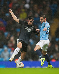 Jack Cork of Burnley (L) and Bernardo Silva of Manchester City in action - Mandatory by-line: Jack Phillips/JMP - 26/01/2019 - FOOTBALL - Etihad Stadium - Manchester, England - Manchester City v Burnley - Emirates FA Cup
