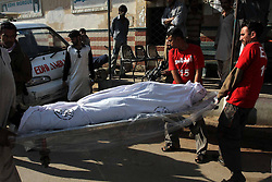 Pakistani rescuers arrange dead bodies of illegal immigrants for identification, who were killed near the border with Iran, in southern Pakistani port city Karachi, December 23, 2012. Photo by Imago / i-Images...UK ONLY