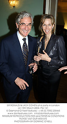 SIR RONALD & LADY COHEN at a party in London on 15th March 2004.PSJ 121