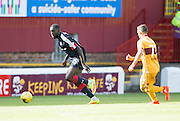 Dundee's Kevin Gomis bursts forward - Motherwell v Dundee in the Ladbrokes Scottish Premiership at Fir Park, Motherwell. Photo: David Young<br />