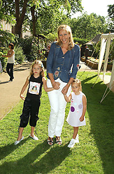 TANIA BRYER and her daughters, Left NATASHA MOUFARRIGE and right FRANCESCA MOUFARRIGE at a children's party to celebrate the launch of the new Baby Dior store in London - held in Eaton Square, London on 8th June 2005.<br /><br />NON EXCLUSIVE - WORLD RIGHTS