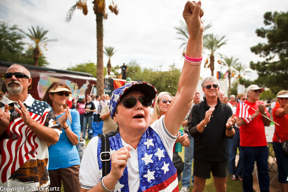 22 OCTOBER 2010 - PHOENIX, AZ:  A woman cheers at a Tea Party rally in Phoenix, AZ, Friday. About 300 people attended a Tea Party rally on the lawn of the Arizona State Capitol in Phoenix Friday. They demanded lower taxes, less government spending, repeal of the health care reform bill, and strengthening of the US side of the US - Mexican border. They listened to Arizona politicians and applauded wildly when former Alaska Governor Sarah Palin and her son, Trig, made a surprise appearance. The event was a part of the Tea Party Express bus tour that is crossing the United States.     Photo by Jack Kurtz