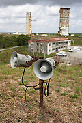 Old weathered loudspeakers stand overlooking a old launchpad at the European Space Agency's Kourou facility in French Guiana.