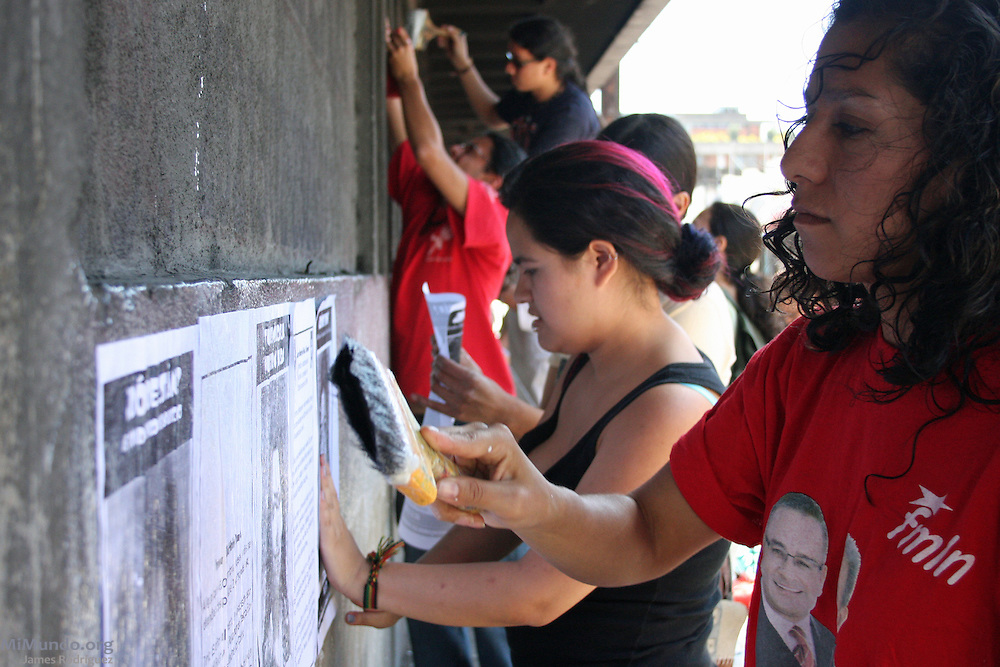 Wendy Méndez (right), founding member of the HIJOS Collective (Spanish acronym for: Sons and Daughters for Identity and Justice, against Forgetfulness and Silence) during a public poster campaign on International Women's Day (March 8th), which also coincides with 25th anniversary since her mother was abducted and disappeared by Guatemalan Security Forces. Through public art, conscience-seeking events and political demonstrations, HIJOS has been seeking truth, justice and the continuance of historical memory with relation to the crimes against humanity committed by the Guatemalan State during its 36-year civil war. Guatemala City, Guatemala. March 8, 2009.