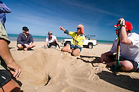 Queensland Parks & Wildlife offer Ian Bell explains to a group of volunteer ecotourists about the plight of endangered turtles on a remote beach on the west coast of Cape York in far northern Australia.
